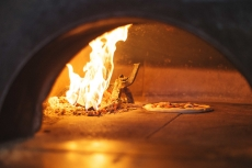 Pizzeria Prima Strada Pizza In the Oven
