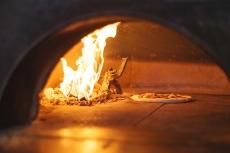 Pizzeria Prima Strada Pizza In the Oven